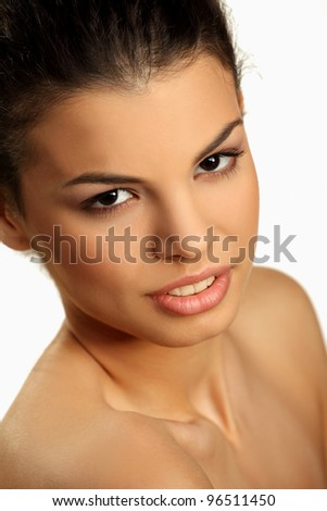 Portrait of a cute young brunette with bare shoulders