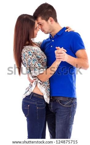 Portrait of a cute young couple dancing isolated on white background