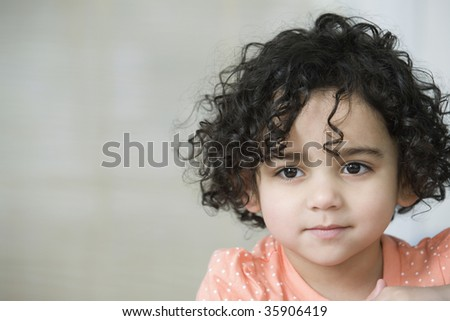 Portrait of a cute young hispanic girl smiling - stock photo