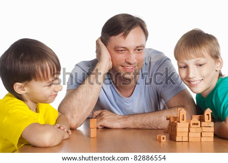 portrait of a dad playing with sons