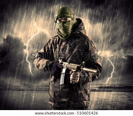 Portrait of a dangerous armed terrorist with mask and gun in a thunderstorm with lightning #510601426