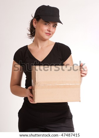 Portrait of a delivery girl in black carrying a parcel
