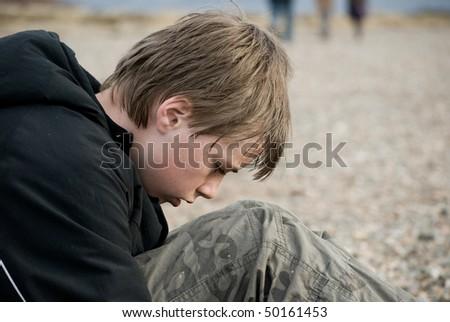 Portrait of a Depressed pre-teen boy. - stock photo