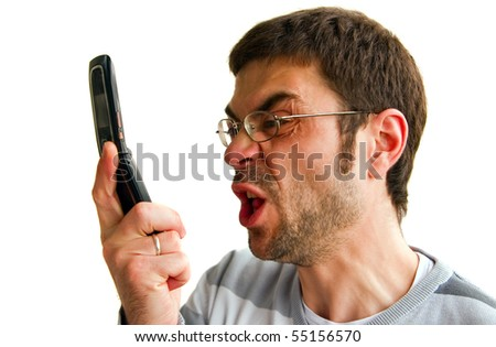 portrait of a displeased furious man, he is talking by phone and screaming, isolated on white background