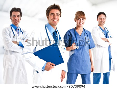 Portrait of a doctor and his team - stock photo