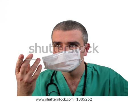 Portrait of a doctor fixing a protection mask on the face,isolated over white background #1385252