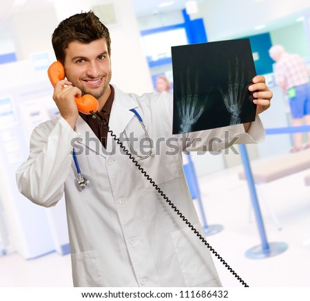 Portrait Of A Doctor Holding Phone And X-ray, Indoor