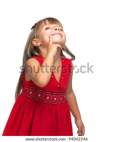 Portrait of a emotional beautiful little girl looking up on white background.