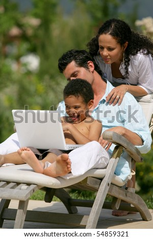 Portrait of a family in front of a laptop computer