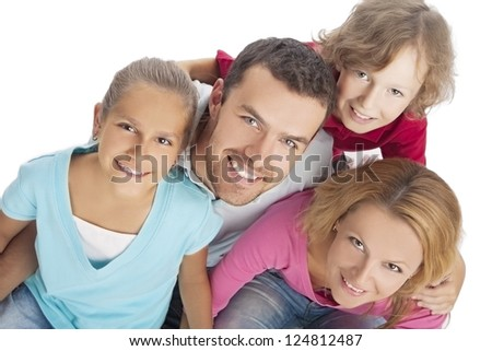portrait of a family looking up and smiling happily over pure white background