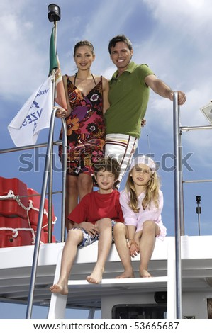 portrait of a family standing on a boat