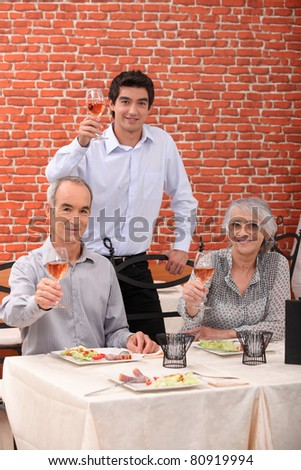 portrait of a family toasting