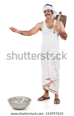 Portrait of a farmer carrying spade on his shoulders and gesturing
