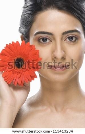 Portrait of a fashion model showing a flower