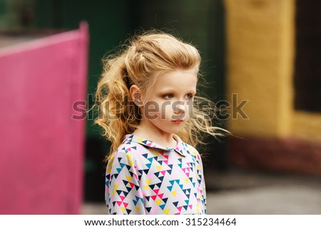 portrait of a Fashionable little girl with beautiful blonde hair
