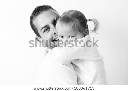 portrait of a father and daughter shot in the studio on a white background