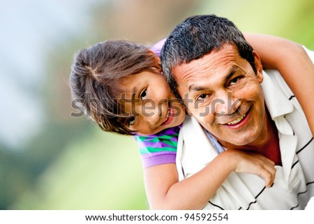 Portrait of a father and his daughter having fun outdoors