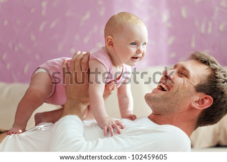 Portrait of a father with his baby daughter