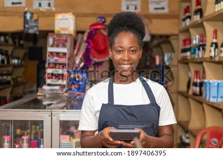 portrait of a female african store attendant smiling Photo stock ©