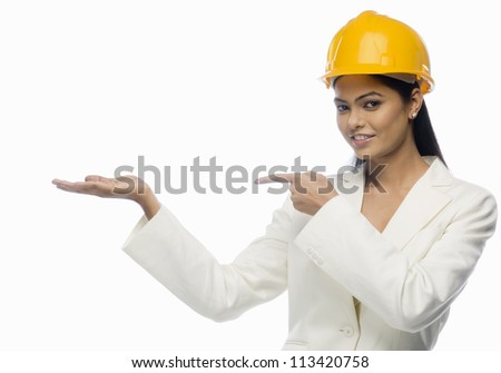 Portrait of a female architect pointing towards her palm