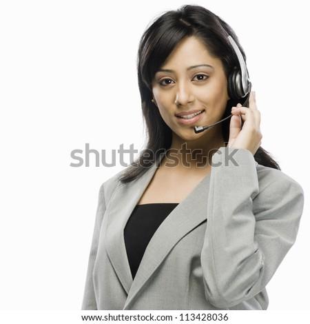 Portrait of a female customer service representative smiling - stock photo
