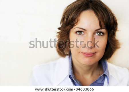 Portrait of a female doctor against a white wall