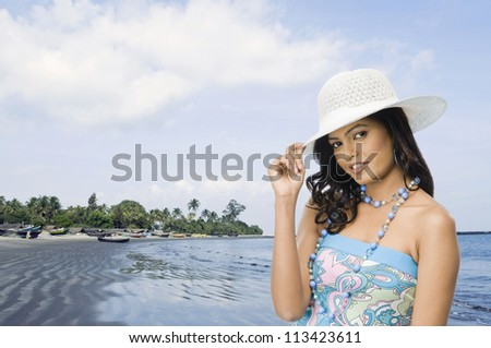 Portrait of a female fashion model posing on the beach