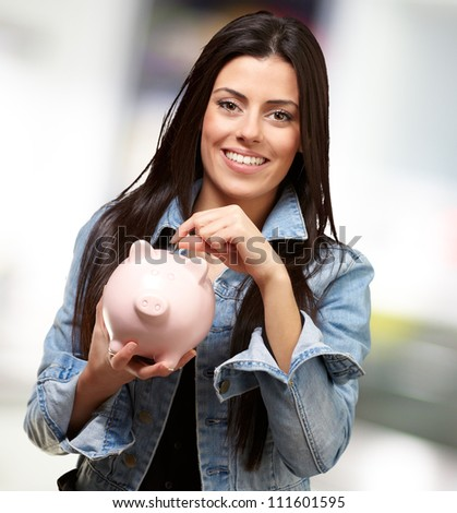 Portrait Of A Female Holding A Coin And Piggy bank, Outdoor