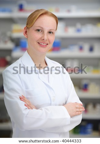 portrait of a female pharmacist at pharmacy