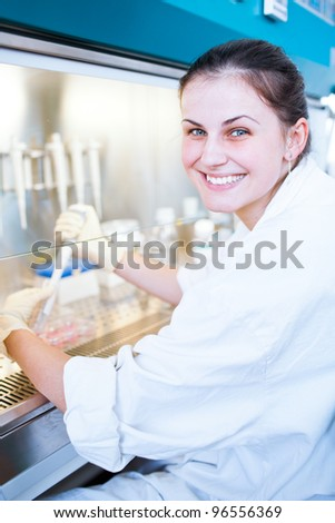 portrait of a female researcher doing research in a lab (color toned image; shallow DOF)