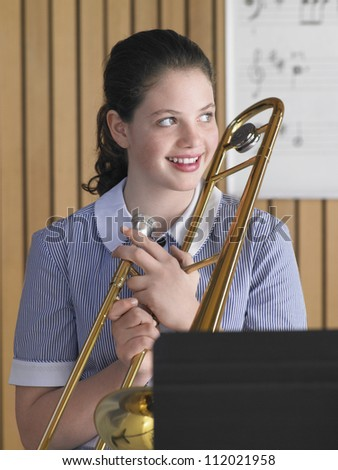 Portrait of a female student with trombone