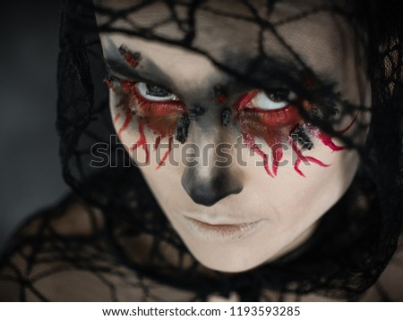 Stock Photo Portrait of a female vampire over black background