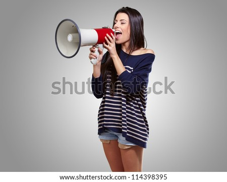 Portrait Of A Female With Megaphone On Gray Background