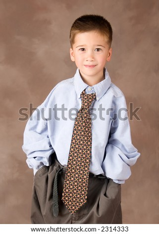 Portrait of a Filipino Boy Dressed up in Adult Business Clothes