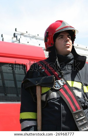 Portrait of a fireman in front of a truck