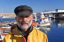 portrait of a fisherman in the harbor