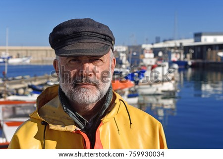 portrait of a fisherman in the harbor #759930034