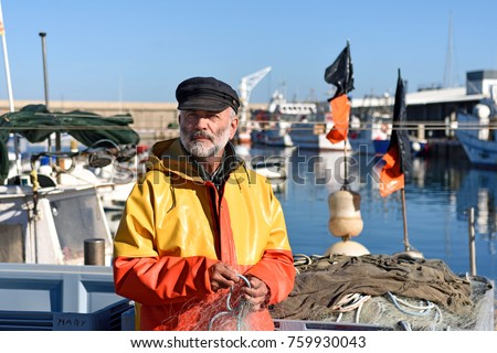 portrait of a fisherman in the harbor #759930043