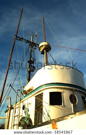 Portrait of a fishing trawler at sunrise.