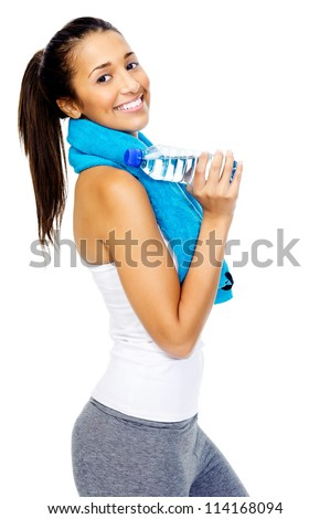 portrait of a fit healthy woman with gym towel and water bottle isolated on white background