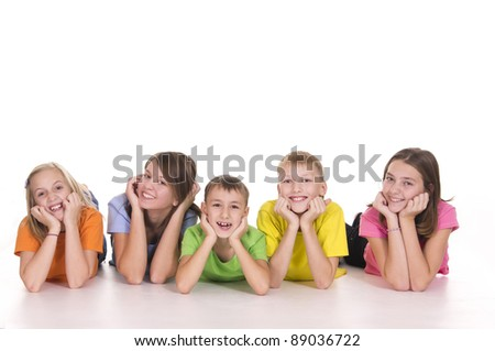 portrait of a five happy kids posing on white