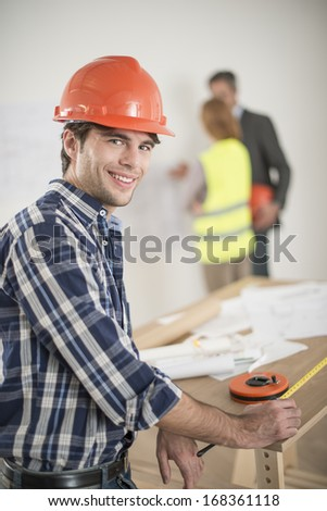portrait of a foreman during a meeting about a build project