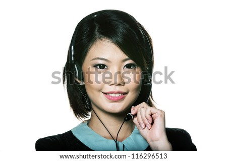 Portrait of a friendly Chinese receptionist wearing headset. Isolated on white.