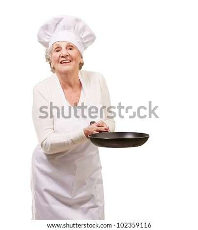 portrait of a friendly cook senior woman holding a pan over a white background