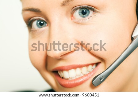 Portrait of a friendly female call center operator