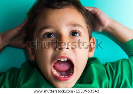 portrait of a frightened boy. the boy screams. #1559963543