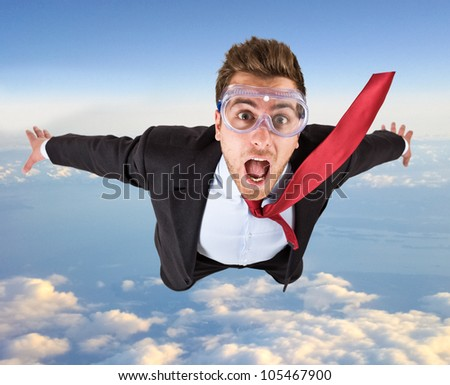 Portrait of a funny businessman skydiving