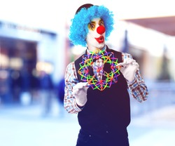 portrait of a funny clown playing with a toy ball