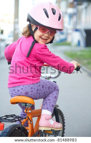 portrait of a funny girl with a bicycle