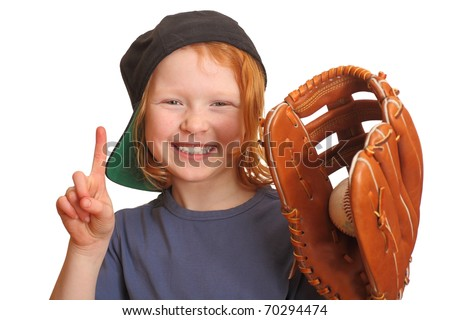 Portrait of a funny red haired girl with baseball cap glove and ball